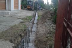 4 Demolizione e ricostruzione muro di confine in c.a.