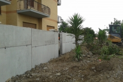 5 Demolizione e ricostruzione muro di confine in c.a.