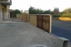 7 Demolizione e ricostruzione muro di confine in c.a.